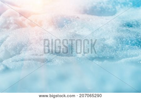 snow snowdrift and sun before christmas, closeup natural winter background