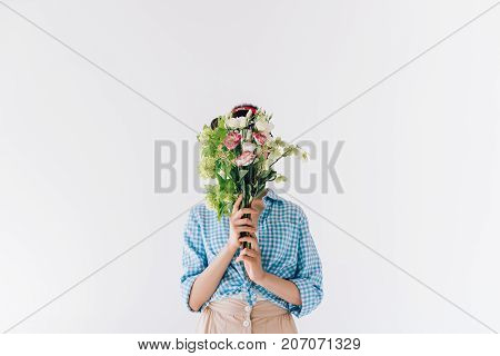 Woman Covering Face With Flowers
