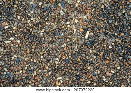 Wet or water on concrete stone or pebble sand floor or ground.