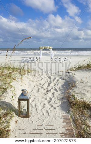 Wedding venue set up for beach wedding with floral arch