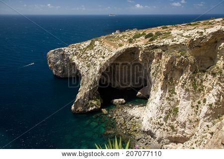 Blue Grotto, famous rock formations and caves attraction at Malta sea shore