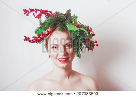 Woman in Christmas wreath. Stylish headdress for holiday party or photo shooting