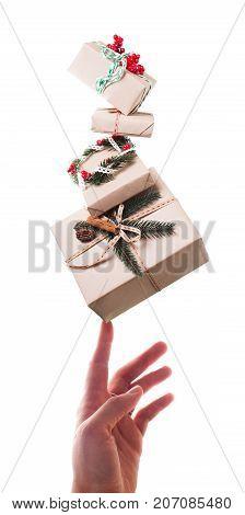 Christmas craft boxes - balance on female hand isolated on white