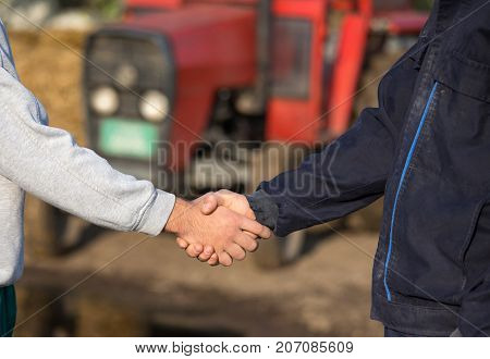 Farmers Shaking Hands On Farm