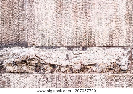 Beautiful stone wall with white seams and different textures