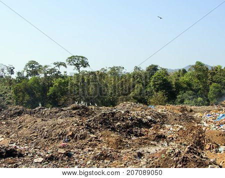 Large garbage dump waste at sunny day