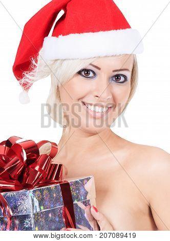 Wonderful female in santa hat with christmas gift