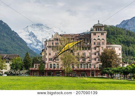 Interlaken Switzerland - May 26 2016: Tandem on the Hang Glider landing against the background of the Swiss Alps in Interlaken Switzerland.