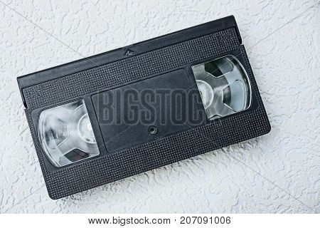 old black videocassette on a gray background
