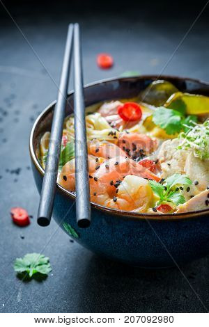 Hot Malaysian Soup With Chicken And Shrimps