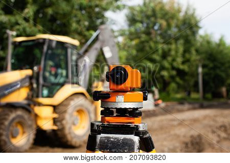 Surveyor equipment for leveling outdoors at  construction of the road
