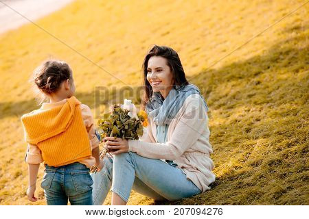 Daughter And Mother In Park