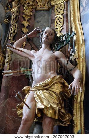 VARAZDIN, CROATIA - JULY 09: Saint Sebastian, statue on altar in cahedral of Assumption in Varazdin, Croatia on July 09, 2016.