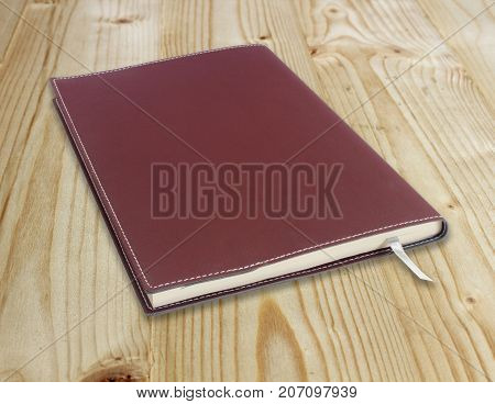 Notebook on the old wooden floor background