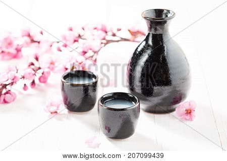 Delicious And Good Sake On White Table