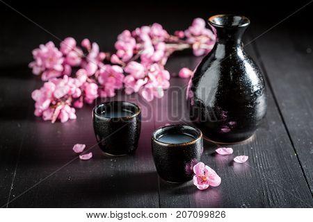 Unfiltered White Sake Sake On Black Table