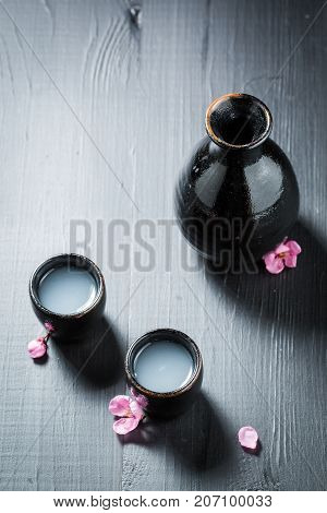 Traditional And Delicate Sake With Flowers Of Blooming Cherry