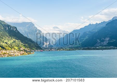 Journey through the cities of Europe. Destination Italy. Gotthard Base Tunnel. Swiss Alps. Canton of Uri. Fluelen and Altdorf from the air.