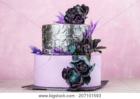 Tiered Wedding Cake With Black Fake Flowers