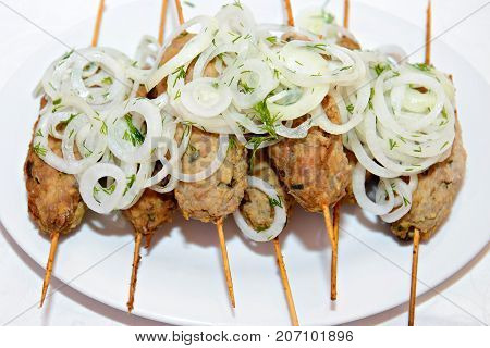 Kebab is a meat dish, common in the Caucasus, Central Asia and Turkey. Minced meat of minced lamb threaded on a skewer and roasted on the grill with onions.