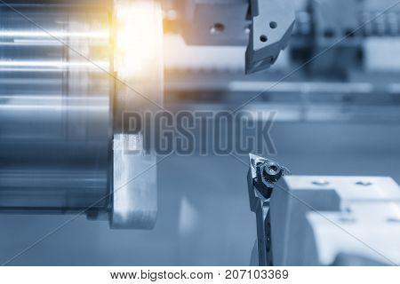 CNC lathe cutting tool in the blue scene .Hi-precision CNC machining concept.
