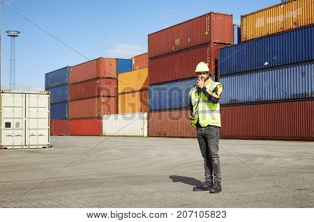 Docker dude in shipyard with cargo containers