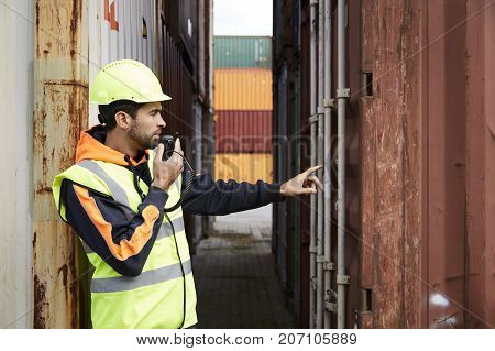 Docker using walkie talkie at dockyard to discuss container