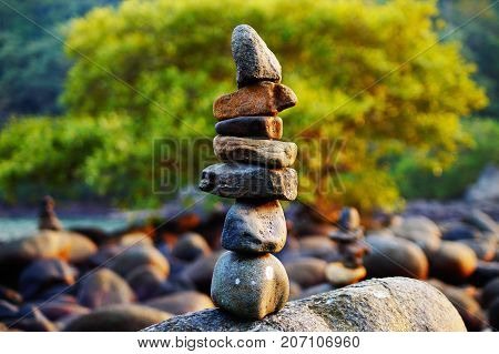 Japanese rock garden on Palolem beach in Goa, India. Zen (dzen) stones. Indian nature. Meditation and relax place on the beach.