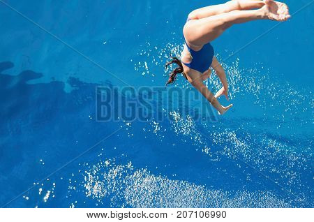 Diving From High, Blue Background, Selective Focus, One Person Only