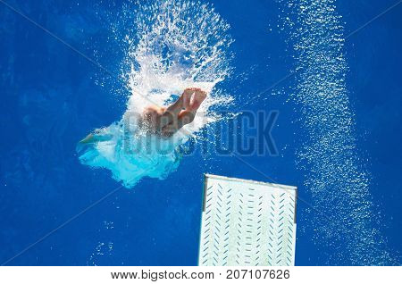 Spring Board Diving, Blue Background, Selective Focus, One Person Only