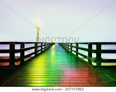Autumn Misty Morning On Wooden Pier Above Sea. Depression, Dark  Atmosphere. Touristic Mole In Mist