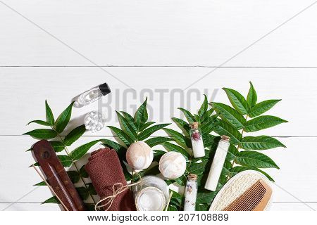 Natural spa and aromatherapy skincare beauty products with bathroom accessories including exfoliating scrubs, oils, sponges, bath bombs and soaps. Top view. Copy space. Still life. flat lay