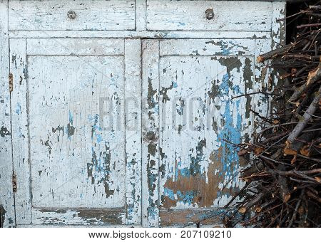 Close-up Of Ancient Light Blue Vintage Rustic Commode Bureau With Paint Peeled Off.