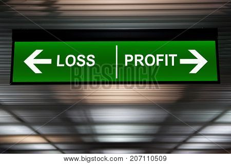 Financial concept. Loss and Profit Arrows sign indicated stock market activity.