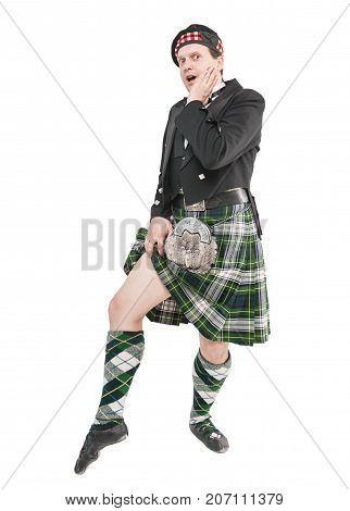 Scottish Man In Traditional National Costume Showing Leg