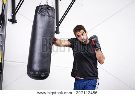 very strong Dude punching bag in gym