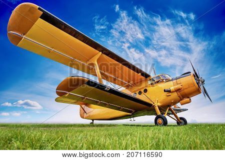 historic biplane a against a cloudy sky