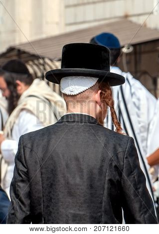 Hasid in a traditional hat on the street in a crowd of pilgrims. Uman Ukraine - 21 September 2017: Rosh Hashanah Jewish New Year.
