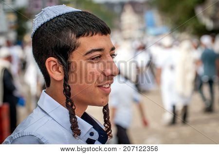 Young hasid in a traditional kippah on the street in a crowd of pilgrims. Uman Ukraine - 21 September 2017: Rosh Hashanah Jewish New Year.
