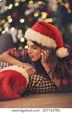 Young pair in love caress at Christmas eve