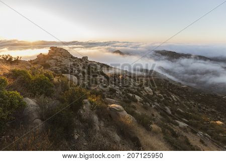 Dawn clouds at Rocky Peak Park above the San Fernando Valley in Los Angeles, California.