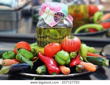 Vegetables: Aubergines, Sweet Peppers, Tomatoes, Hot Chili, Carrots, Zucchini, Zucchini. Glass Jar W