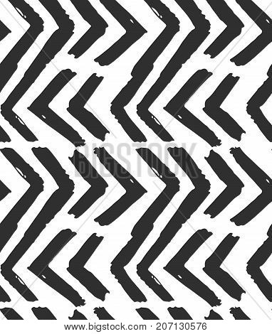 Hand drawn vector abstract rough geometric monochrome seamless zig zag chevron pattern in black and white colors.Hand made grunge brush painted texture.Scandinavian concept design for fashion, fabric