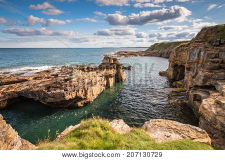 Rocky Cove at Rumbling Kern, near Howick on the Northumberland coastline, lies a small beach and cove sheltered by small cliffs