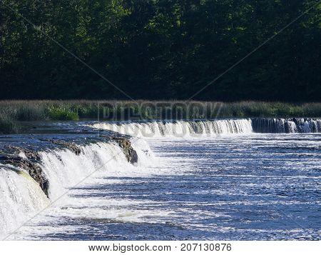 Waterfall Ventas Rumba on river Venta at Kuldiga Latvia selective focus.