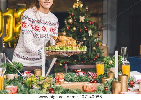 Woman Serving Christmas Table With Chicken