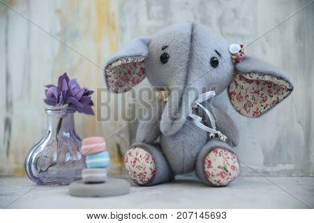 Handmade Toy Gray Elephant With Purple Flower
