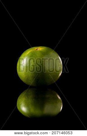 Tangerine Green Orange Fruit On A Black Reflective Background