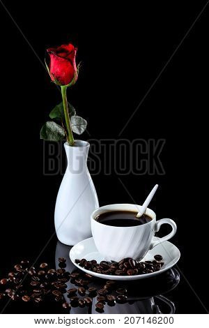 Composition Of Coffee And Red Rose On A Black Reflective Background