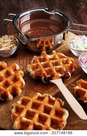 Belgium waffles with chocolate sauce. popsicles with chocolate and wafer.